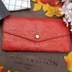 Louis Vuitton  Empreinte wallet Genuine